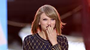 Taylor Swift Gets Wet for Rolling Stone, Talks Keeping Her